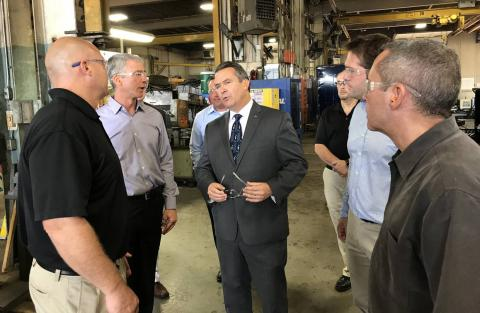 Photo: Elliott Equipment Chief Executive Jim Glazer, center left, talked with U.S. Rep. Don Bacon (R., Neb.), center, and Association of Equipment Manufacturers Vice President, Public Affairs & Advocacy Kip Eideberg, a lobbyist, at the company's Omaha manufacturing plant in September. PHOTO: THEO FRANCIS/THE WALL STREET JOURNAL